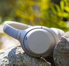 Sony WH1000XM3 over-ear headphones on a rock outside in nature