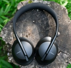 Bose over-ear Headphones 700 on a piece of wood outside in nature