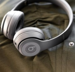 Beats Solo3 workout on-ear headphones on a olive fabric