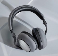 Bowers & Wilkins PX7 over-ear headphones on a gray surface