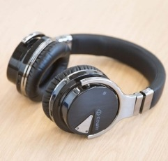 COWIN E7 over-ear headphones on a wooden surface