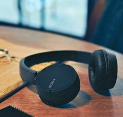 Sony WH-CH500 on-ear headphones on a wooden table