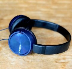 Sony MDRZX310 on-ear headphones on a wooden surface