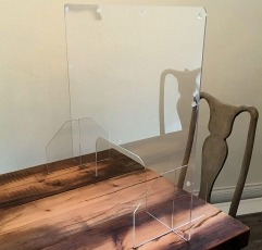 POS Display Shop Protective Sneeze Screen Guard on a table