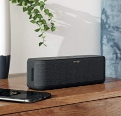 Anker Soundcore Boost bluetooth speaker on a wooden table