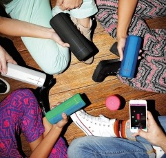Ultimate Ears BOOM 2 Lite bluetooth speakers with a group of friends