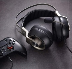 Mpow EG3 Pro gaming headset next to a controller