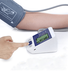 CAZON medium cuff Blood Pressure Monitor used by a man on a table