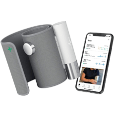 Withings Core - Electric Blood Pressure Monitor on white background next to a smartphone