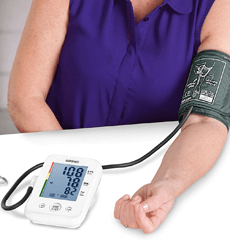 Duronic Blood Pressure Monitor used by a woman on a table