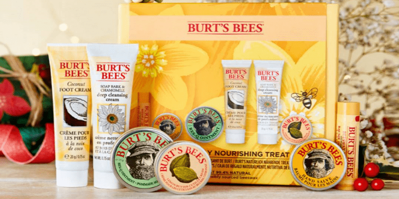 Burt's Bees Naturally Nourishing Treat Box on a wooden table