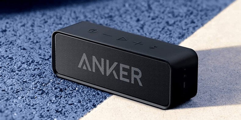 Anker SoundCore bluetooth speaker on a white and blue surface