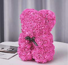 pink rose bear on table