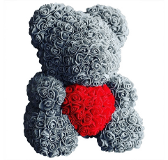 grey rose bear with red heart on white background