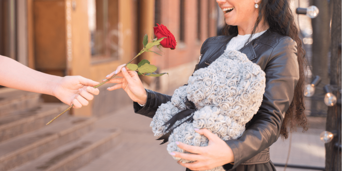 happy woman received a rose bear and a rose on her special day