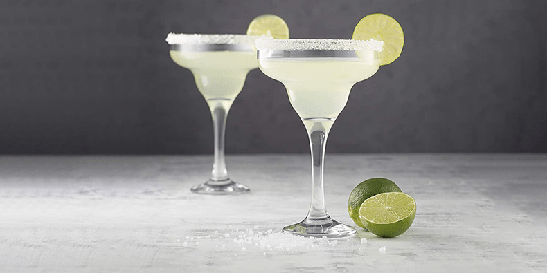 Ravenhead Set Of 2 Margarita Glasses on a table