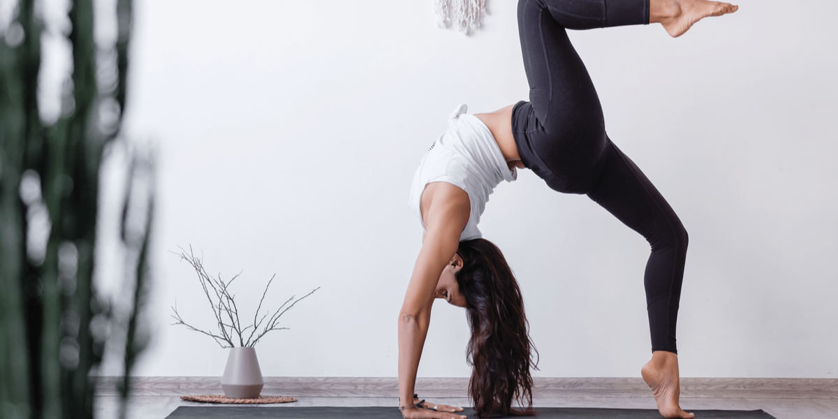 Woman doing yoga with leggings at home