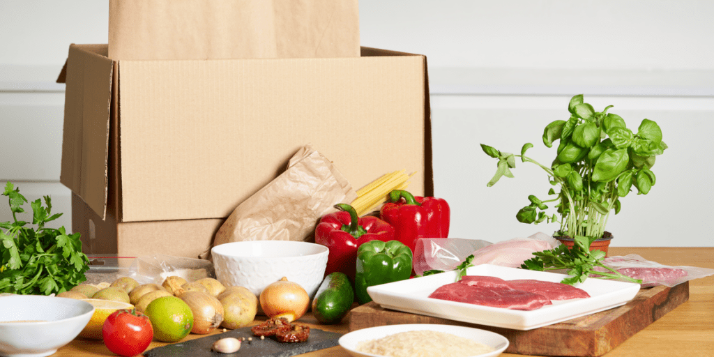 A box from a meal delivery service with many ingredients