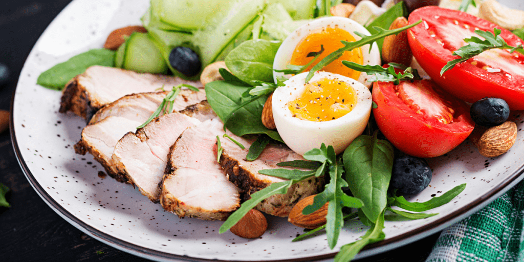 keto diet plan dish with delicious food, eggs, tomatoes, almonds, spinach, baby roca