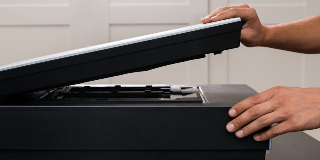 man scanning a photo with a photo scanner