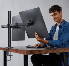 man using the HUANUO Dual Monitor Stand