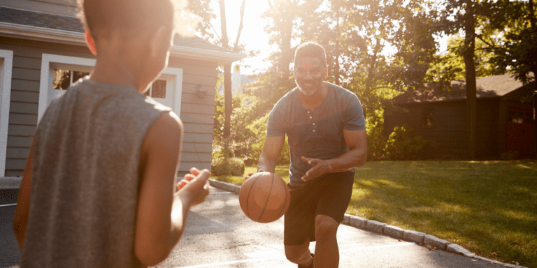 happy dad plays basketball in the garden with his kid with the best basketball stands