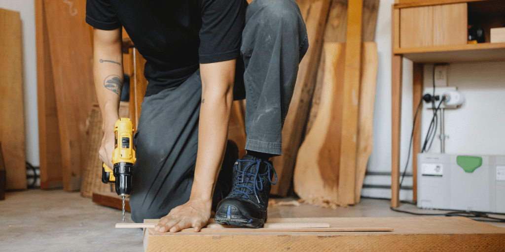 man doing carpentry and wearing one of the best safety boots