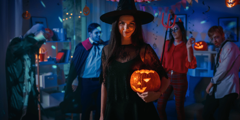 Woman dresses in Halloween themed party holding a pumkin